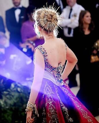 A look at the back of Blake Lively's dress and hair at the 2018 met gala, red and gold gown with gold circle crown
